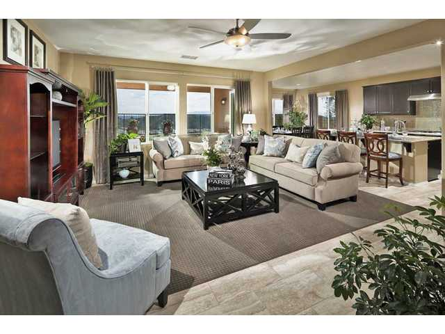 This family room of a Shapell Homes' Heatherton development sits on a hillside off Plum Canyon Road in Santa Clarita. The purchase price of the home includes many eco-friendly and energy-saving features, such as custom-designed landscaping.