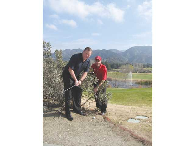 Left to right, Bob Kellar and Mike Berger in the rough at Robinson Ranch Golf Club.