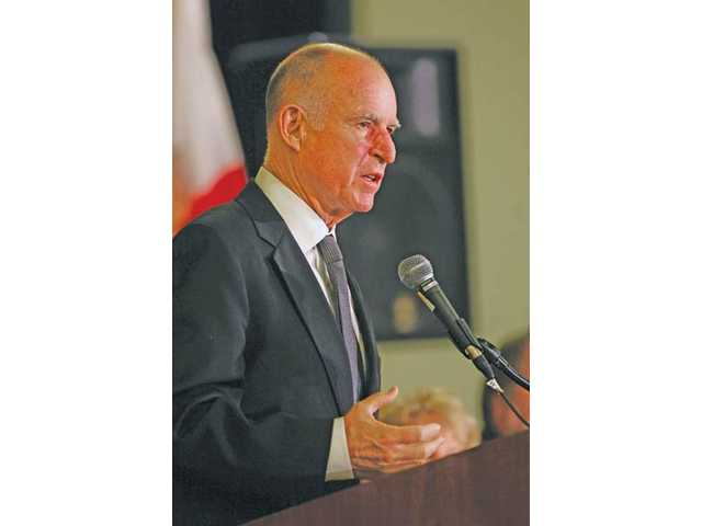 Gov. Jerry Brown outlines his revised budget proposal during a recent news conference at the Capitol in Sacramento.