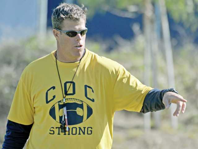 College of the Canyons head coach Garett Tujague leads a drill during spring practice on Tuesday on the COC campus. The Cougars finished 6-5 in 2010, unfamiliar results for a program that's won 82 percent of its regular-season games since 2002.