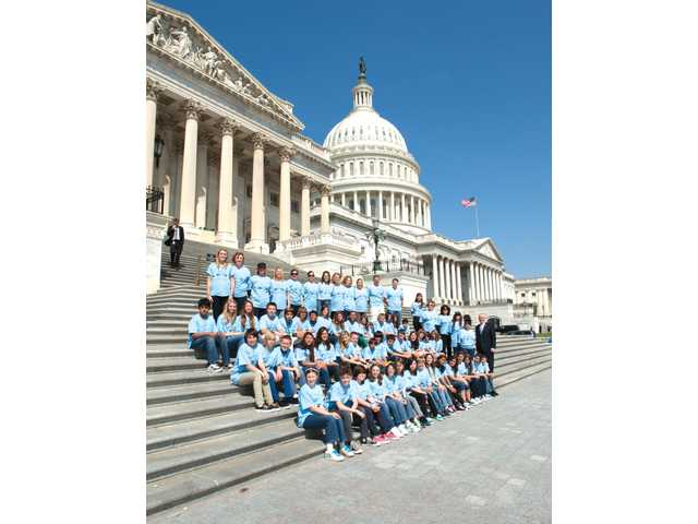 "A group of students from Santa Clarita Valley International pose with Congressman Howard ""Buck"" McKeon, R-Santa Clarita on the steps of the Capital in Washington, D.C., on Friday, as part of a field trip organized by the school."