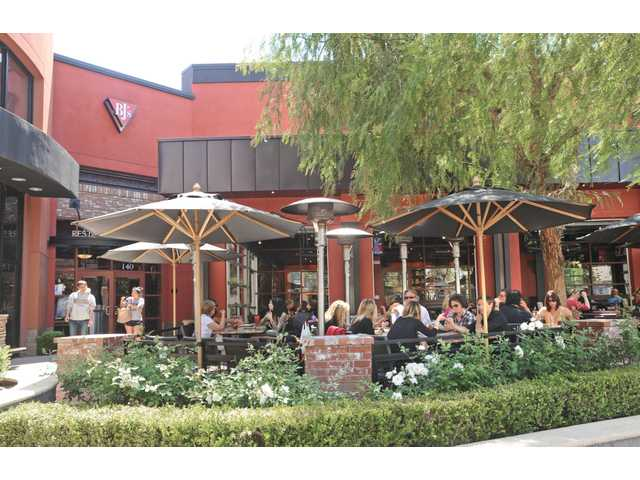 Customers eat lunch in the outdoor dining area at BJ's restaurant in Valencia. The company reported 1st quarter sales increased 7.8 percent over 2010 and announced plans to open a dozen new restaurants this year.