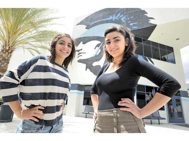Twin sisters realize American dreams