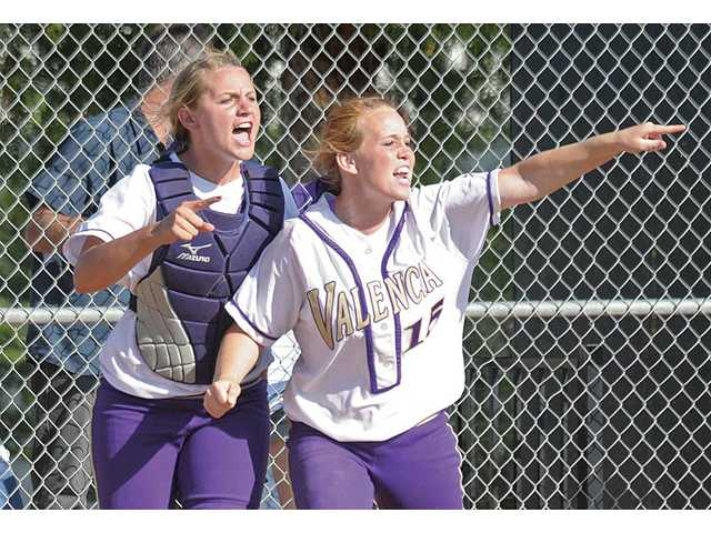 Vikings catcher Karlie Habitz, left, and pitcher Carly Mortensen cheer on baserunners after Missy Fundora's two-run double against El Modena on Thursday at Valencia High. The Vikings fell 5-4 in the CIF-Southern Section Division I quarterfinals.