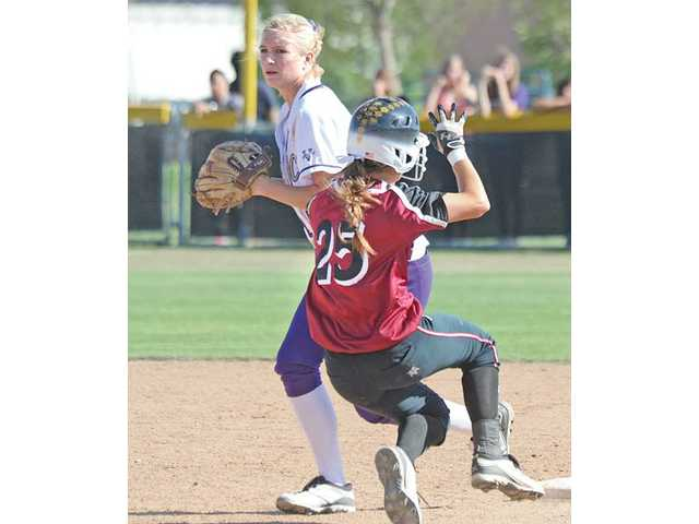 Vikings shortstop Justine Sibthorp, back, forces out El Modena baserunner Sam Mazza during the sixth inning of their CIF-Southern Section Division I quarterfinal matchup on Thursday at Valencia High. El Modena beat Valencia 5-4.