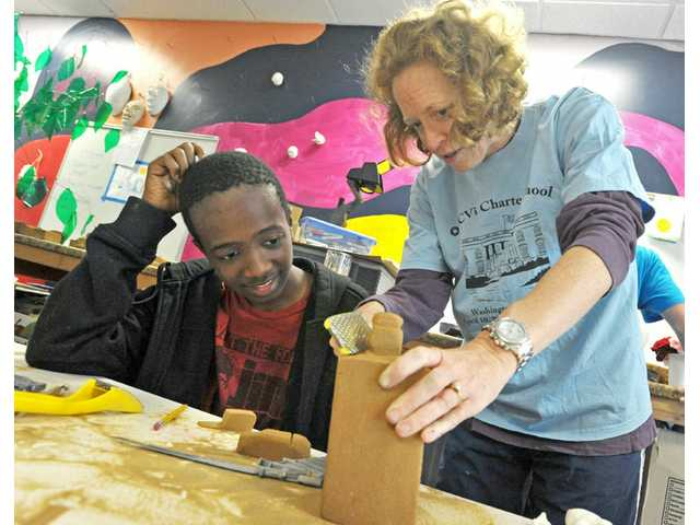 Instructor Kim Adam, right, helps eighth-grader Daljeem Holmes, 14, create a demon gargoyle at SCV International Charter School in Castaic on Tuesday.