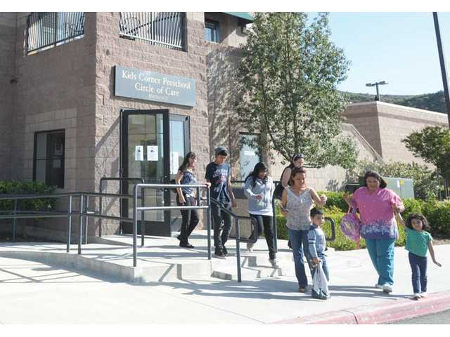 Parents pick up their children at The Child & Family Center in Santa Clarita on Wednesday. The state is in talks to transfer operations of the preschool to a third party.