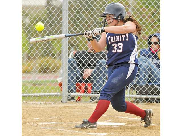Trinity Classical Academy catcher Kaeli Massetto gets a hit during a 12-2 win over Santa Clarita Christian on April 7.