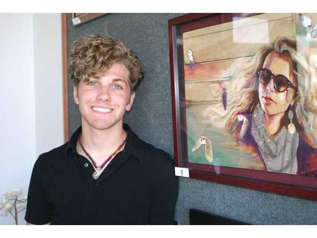 "Valencia High School senior Tyler Recchia stands with his artwork ""Kayla's Dream."" Recchia is the winner of this year's Congressional art contest, representing the 25th Congressional District."