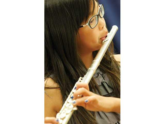 Oak Hills Elementary sixth-grader Lindsey Ching, 12, plays her flute during the Newhall School District's 33rd annual Spring Concert.