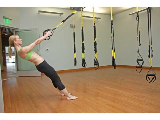 YogaWorks in Valencia offers a selection of new workouts. YW-X is circuit training that integrates strength, flexibility and cardio, utilizing TRX suspension trainers, gliding discs and one's own body weight among other tools.