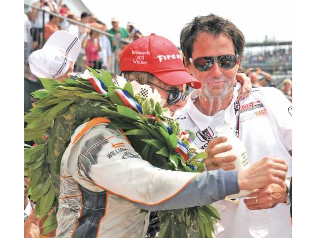 Valencia resident and Hart High graduate Bryan Herta, co-owner of Bryan Herta Autosport, celebrates with driver Dan Wheldon after winning the Indianapolis 500 on Sunday in Indianapolis. Herta and Wheldon teamed up on a one-race contract.