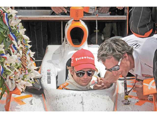 Valencia resident and Hart High graduate Bryan Herta, right, congratulates driver Dan Wheldon after winning the Indianapolis 500 on Sunday in Indianapolis. The victory was the first in the IZOD IndyCar Series for the Herta-co-owned Bryan Herta Autosport.