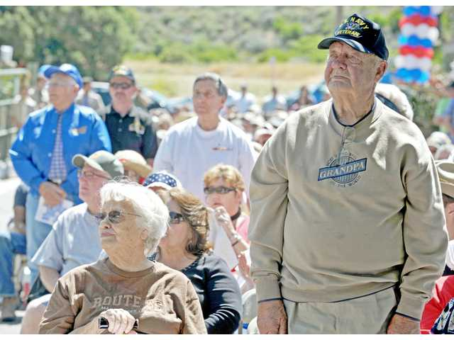 Lester Eernisse, of Reseda, right, is recognized along with other Navy veterans during a Memorial Day tribute at Eternal Valley Memorial Park in Newhall on Monday.  Eernisse participated in the battles of Iwo Jima and Okinawa during World War II.