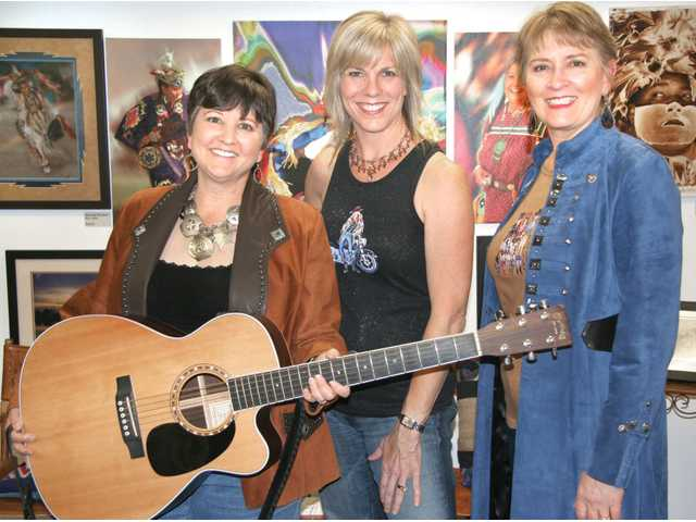 Singer-songwriter Trish Lester and her group, Women on the Move Trio, won First Place in the singing competition at the 51st annual Topanga Banjo-Fiddle Contest/Folk Festival on May 15, out of a field of more than 35 contestants. Left to right, Joan Enguita, Linda Geleris and Trish Lester.