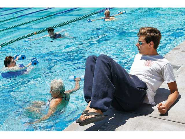 Lifeguard Johnny Howell gives instructions to seniors participating in the Aqua Aerobics class held at the Santa Clarita Aquatic Center in Canyon Country on Wednesday.