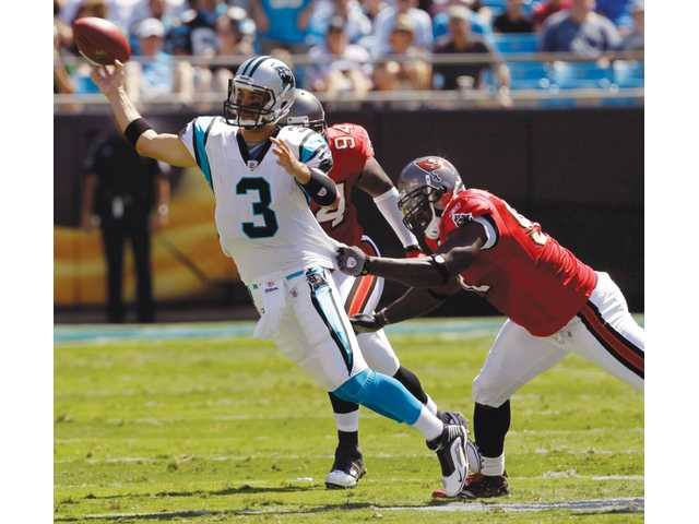 Hart High graduate and Carolina Panthers quarterback Matt Moore (3) throws a pass under pressure from Buccaneers defensive ends Stylez White (91) and Kyle Moore on Sept. 19, 2010, in Charlotte, N.C. Moore wants to rebound after a rough 2010 season, but injuries and the lockout have slowed his offseason.