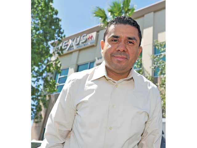 Castillo stands in front of the company's Valencia headquarters.