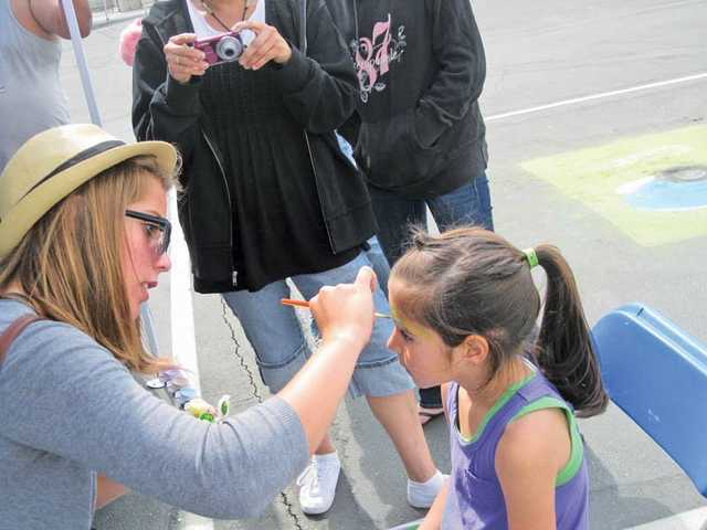 Kindergartner Niki Staudinger gets her face painted during the Valley View Community School Spring Spectacular Carnival on May 14. The event gave families a day of games, food and entertainment. Among the events were chalk art on black top, a performance from the school chorus and a gallery walk.