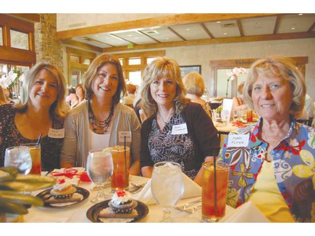 Left to right, Henry Mayo Newhall Memorial Health Foundation Holiday Home Tour members Pam Di Valerio, Kathy Phillipson, Donna Leonhardt, and Mary Flynn enjoy the fashion show and luncheon at Valencia's The Oaks Grille at Tournament Players' Club.
