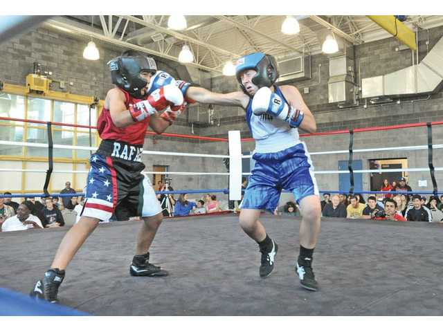 Diego Renteria, 11, right, of Santa Clarita, lands a punch on Rafael Delgado, 11, of Pacoima, during their bout at the USA Boxing Inc. Santa Clarita Boxing Club Show held at the Newhall Community Center on Saturday.