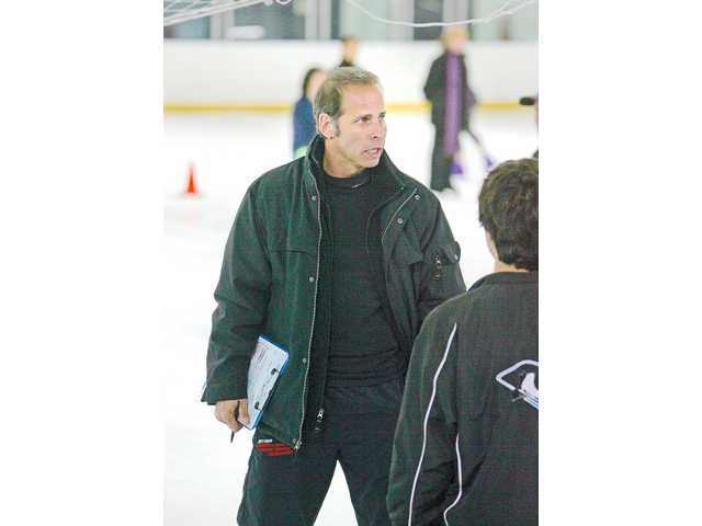 Lloyd Eisler, four-time Olympian and two-time Olympic bronze medalist, left, is seen on the ice at L.A. Kings Valley Ice Center.
