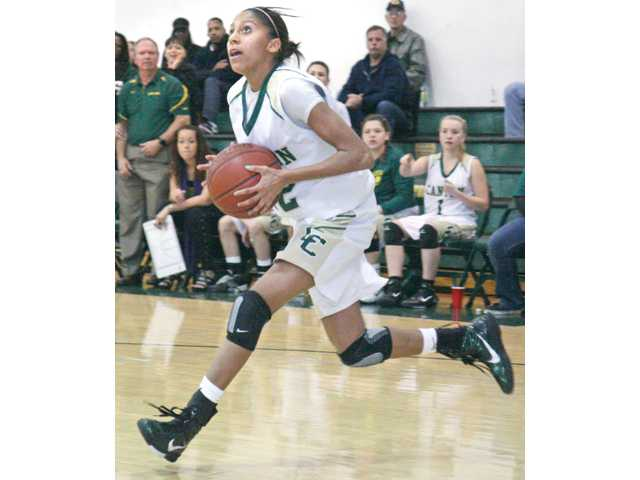 Led by Foothill League Player of the Year Shorty Dent (pictured), the Canyon girls basketball team repeated as league champions, reached the CIF-Southern Section Division IIAA semifinals and won the first state playoff game in program history.