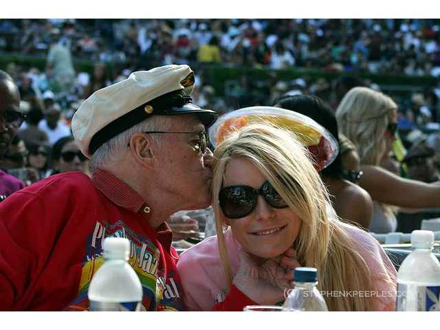 The 33rd annual Playboy Jazz Festival at the Hollywood Bowl on Saturday, June 11, was the last time Playboy founder Hugh Hefner and soon-to-be-former-fiance appeared in public. This could be their last kiss. Their engagement was off less than 24 hours later.