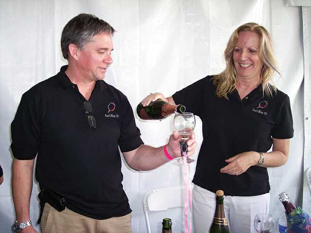 Ed and Eve Bushman pour sparkling wines at the Vine 2 Wine Classic held to benefit the Circle of Hope breast cancer support group.