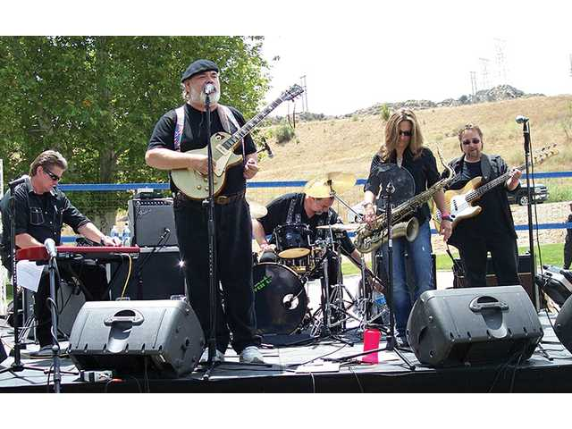 The Stagg Street Rhythm Section plays during the Vine 2 Wine Classic held at Mann Biomedical Park in Valencia.