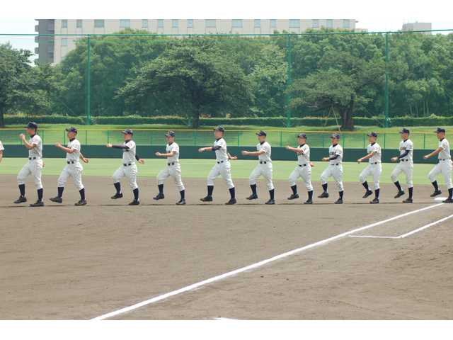 The Akashi Commercial High School team marches out on to the field to face the United States Friendship Series team.