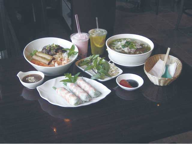 Meals of dreams: Clockwise from front, Shrimp Spring Rolls, vermicelli with egg rolls and beef, Strawberry Boba, sweet tea with orange and mint, and Pho Dac Biet soup, which you can spice up as you like it.