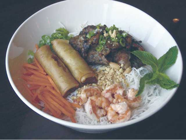 Vermicelli with grilled shrimp, egg rolls and charbroiled beef.