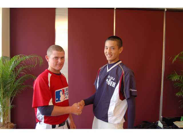 West Ranch High pitcher J.C. Cloney shakes hands with a Japanese pitcher who throws 94 MPH, the hardest thrower in Osaka, Japan.