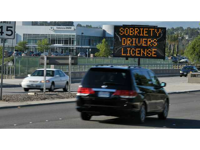 An electronic sign warns drivers traveling eastbound on Valencia Boulevard, east of Creekside Road, of the DUI checkpoint in Valencia on Friday.
