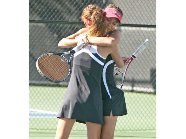 Valencia sisters Clarice and Emily Fraczek won their third straight Foothill League doubles championship this season.