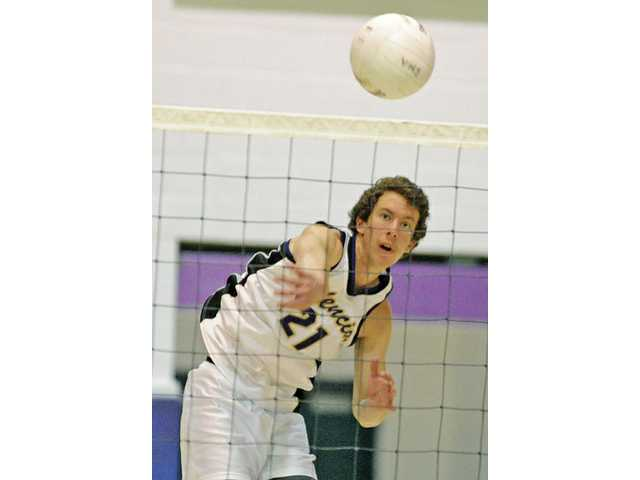 Broc Oppler helped the boys volleyball team win its state-record 102nd consecutive league match.