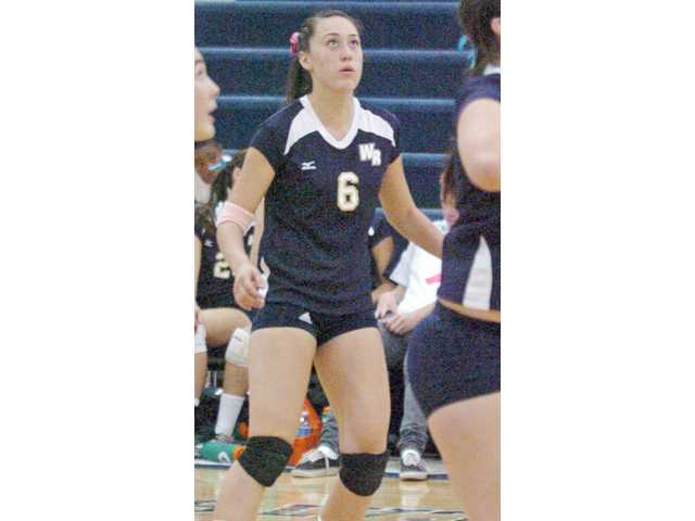 Senior Hannah Orlandi and the girls volleyball team tie for second in league.
