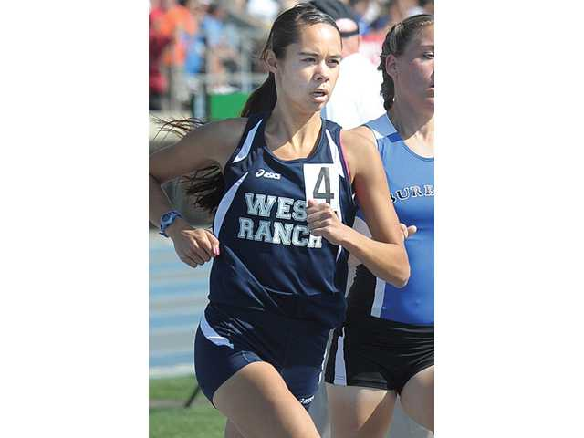 Distance runner Jennifer Owen set a new league record in the 800-meter run at the Foothill track and field finals with a time of 2 minutes, 12.84 seconds.