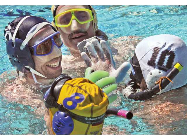 Colorado team captain Phil Hickey, left, and Nate Rust, right, of Los Angeles shake hands after LA beat Colorado 4 - 0 as 16 teams from across the country competed in the Underwater Hockey National Tournament.