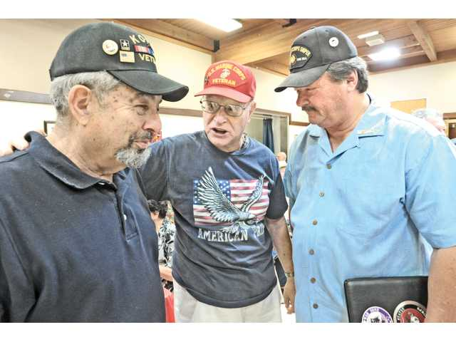 Veterans, from left, Jerry Schwartz, Carl Woerter, and Dick Jeffrey chat at the SCV Senior Center in Newhall on Saturday.