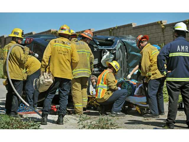 Car overturns on Newhall Ranch Road