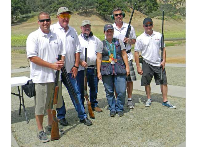 Rhode poses with the trap-shooting team of Santa Clarita Concrete headed by Wayne Crawford, third from left.