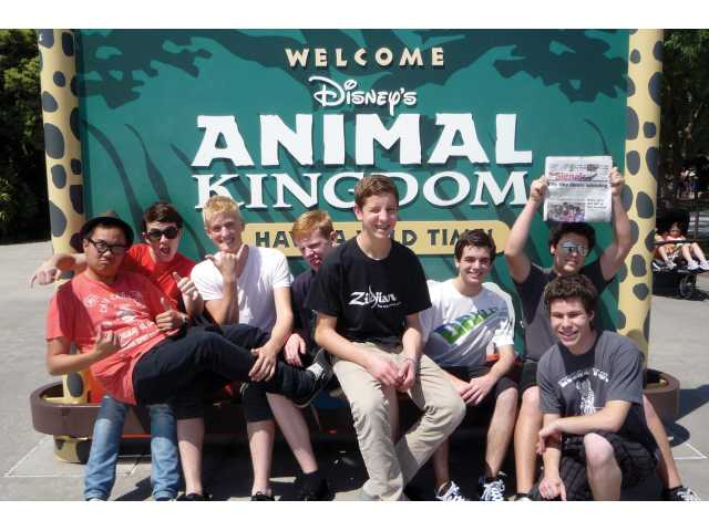 Kevin Tran, Justin Beirold, Thomas McCarthy, Sam Lowen, Chad Nix, Sam Falcone, Lance Cardey (holding Signal) and Micah Altman, all students of the Hart High School wind ensemble, traveled to Disney World to participate in the Disney Honors.