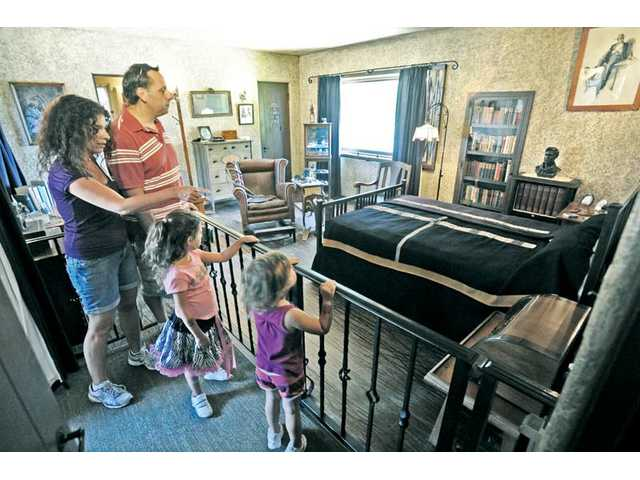 The Siebaldi family, of Newhall, Lisa, left, Mario and their children Lucia, 5, and Francesca, 3, right, visit William S. Hart's bedroom as they take a guided tour of the William S. Hart Museum in Newhall on Saturday.