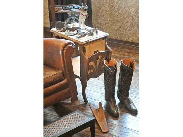 A few of those pieces of history, including Hart's boots and spurs, sit in his bedroom.