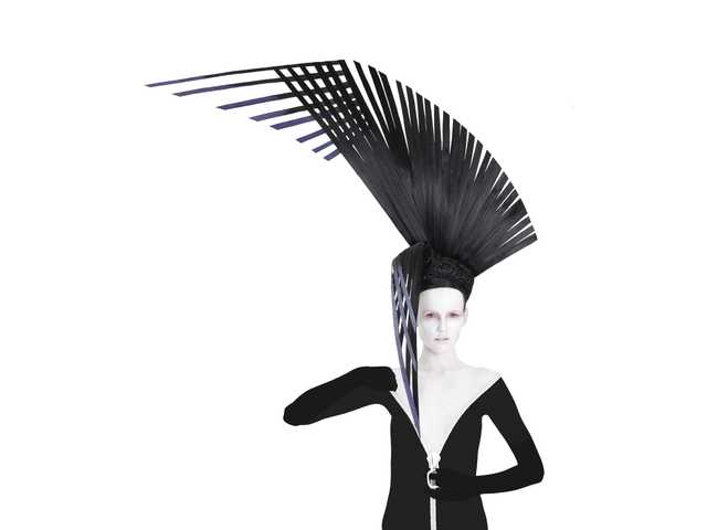 "Dan Csicsai of Salon Glo in Valencia created this""off-the-wall"" hair sculpture to enter in the avant garde category at the Professional Beauty Association's North American Hairstyling Awards. Human hair is used to create these unusual hairpieces that are then attached to the model."