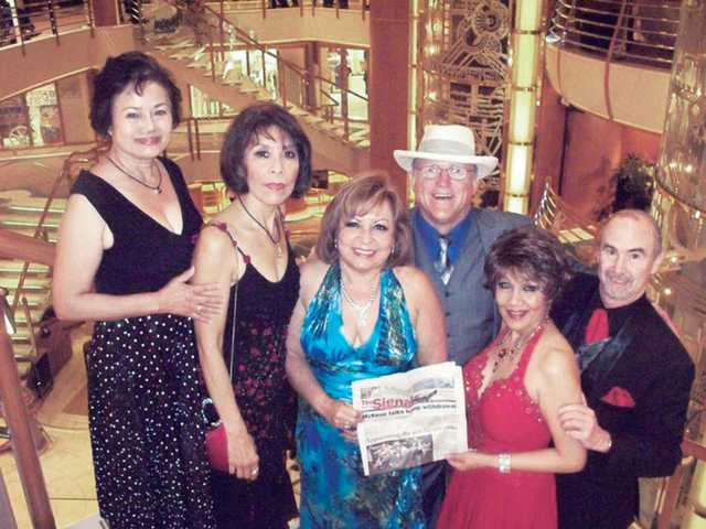 From left to right Hanna, Gloria Barcarse-Szabo, Jeannie Atkins, B.J. Atkins, Edna Coe and Michael Donovan, pose in the atrium of the Sapphire Princess cruise ship during a trip to Hawaii  from  the port of Los Angeles.