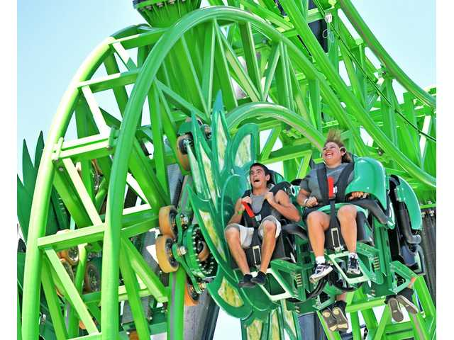 Christian Formaini, 15, of Stevenson Ranch, and Suzanne Duggan, 41, of Salida, enjoy Green Lantern: First Flight at Six Flags Magic Mountain on Thursday.