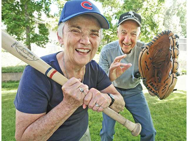 Baseball fans, Ellie and John Fuller, in their backyard in Newhall. The couple have visited every Major League ballpark in North America.